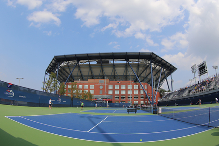 luis: NEW YORK - SEPTEMBER 1, 2015: Practice courts and newly Improved Arthur Ashe Stadium at the Billie Jean King National Tennis Center ready for US Open tournament in Flushing, NY Editorial