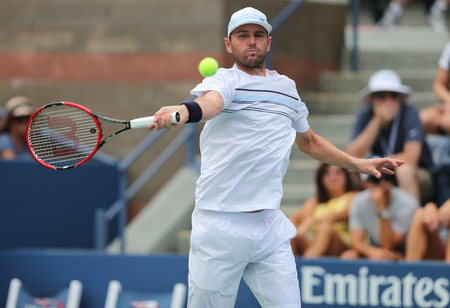 NEW YORK - AUGUST 31, 2015: Professional tennis player Mardy Fish of United States in action during his opening match at US Open 2015. Mardy Fish retires after US Open 2015