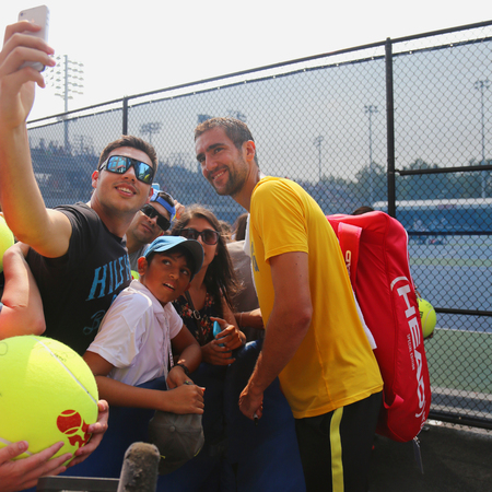 marin: NEW YORK - SEPTEMBER 3, 2015: Grand Slam champion Marin Cilic of Croatia taking selfie with fan after practice for US Open 2015 at Billie Jean King National Tennis Center  in New York