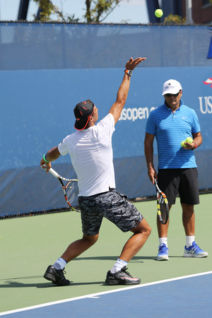 billie: NEW YORK - AUGUST 27, 2015: Fourteen times Grand Slam Champion Rafael Nadal of Spain with his coach Tony Nadal practices for US Open 2015 at Billie Jean King National Tennis Center in New York Editorial