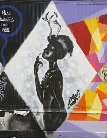 lower east side: NEW YORK - APRIL 16, 2015: Mural art in Lower East Side in Manhattan. A mural is any piece of artwork painted or applied directly on a wall, ceiling or other large permanent surface