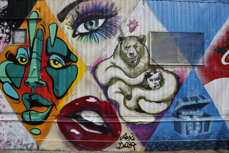 bowery: NEW YORK - APRIL 16, 2015: Mural art in Lower East Side in Manhattan. A mural is any piece of artwork painted or applied directly on a wall, ceiling or other large permanent surface