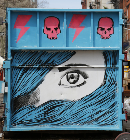 NEW YORK - APRIL 16, 2015: Mural art in Lower East Side in Manhattan. A mural is any piece of artwork painted or applied directly on a wall, ceiling or other large permanent surface