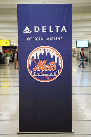 best travel destinations: EW YORK - OCTOBER 25, 2015: Delta Official Airline of New York Mets sign inside of Delta Airline Terminal 4 at JFK International Airport in New York.