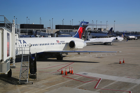 best travel destinations: CHICAGO, ILLINOIS - OCTOBER 25, 2015: Delta Airlines plane at the gate at O Hare International Airport in Chicago