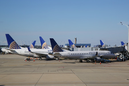 best travel destinations: CHICAGO, ILLINOIS - OCTOBER 25, 2015: United Airlines planes at the gate at O Hare International Airport in Chicago