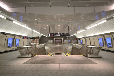 municipal editorial: NEW YORK - OCTOBER 22, 2015:34 Street -Hudson Yards Subway station interior design in NY. The new 34th Street Hudson Yards line 7 extension is the first new subway station built by the MTA in 26 years