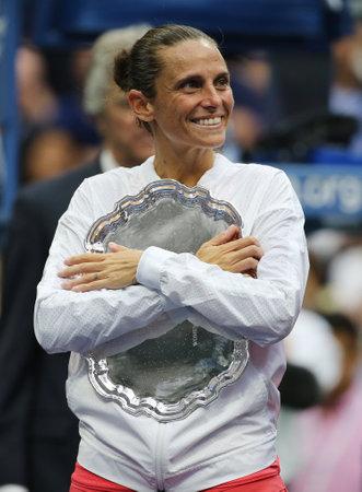 racket stadium: NEW YORK - SEPTEMBER 12, 2015:US Open 2015 finalist Roberta Vinci of Italy during trophy presentation after women s final match at US OPEN 2015 at Billie Jean King National Tennis Center in New York