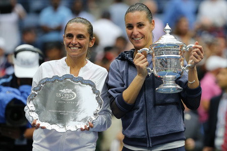 finalist: NEW YORK - SEPTEMBER 12, 2015:US Open 2015 finalist Roberta Vinci L and US Open 2015 champion Flavia Pennetta of Italy during trophy presentation after women s final match at National Tennis Center Editorial