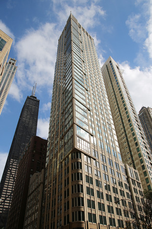 hancock building: CHICAGO, ILLINOIS - OCTOBER 24, 2015: Modern condominium and John Hancock Center in downtown Chicago Editorial