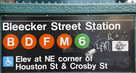 owned: NEW YORK CITY - APRIL 16, 2015: Bleecker Street  Subway Station entrance in Manhattan. Owned by the NYC Transit Authority, the subway system has 469 stations in operation