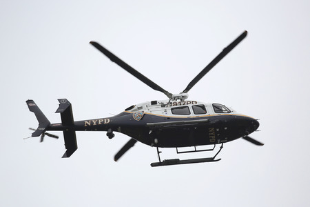 press agent: BROOKLYN, NEW YORK - NOVEMBER 1, 2015: NYPD Bell 429 helicopter in the sky providing security during New York City Marathon start in Brooklyn Editorial