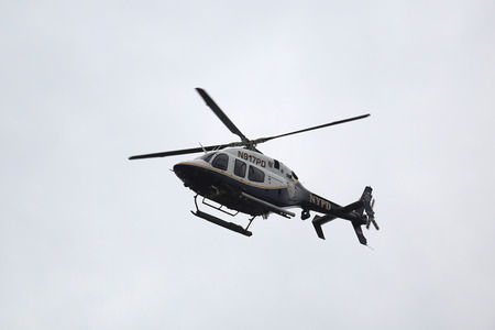 BROOKLYN, NEW YORK - NOVEMBER 1, 2015: NYPD Bell 429 helicopter in the sky providing security during New York City Marathon start in Brooklyn Editorial