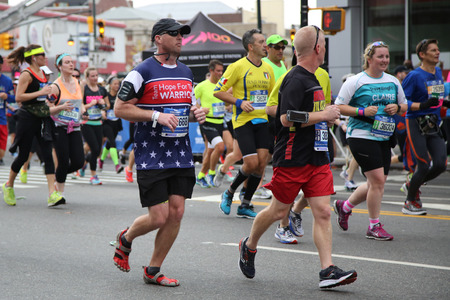 marathon: NEW YORK - NOVEMBER 1, 2015: New York City Marathon runners traverse 26.2 miles through all five NYC boroughs to the finish line in Central Park, Manhattan