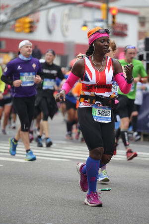 boroughs: NEW YORK - NOVEMBER 1, 2015: New York City Marathon runners traverse 26.2 miles through all five NYC boroughs to the finish line in Central Park, Manhattan