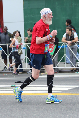traverse: NEW YORK - NOVEMBER 1, 2015: New York City Marathon runners traverse 26.2 miles through all five NYC boroughs to the finish line in Central Park, Manhattan