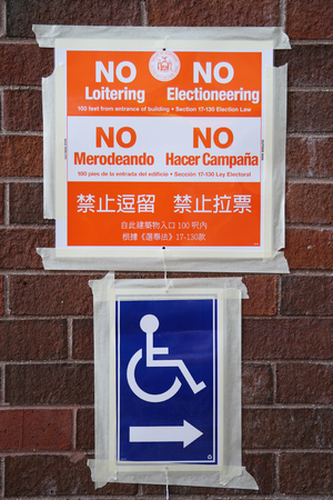prohibits: NEW YORK - NOVEMBER 3, 2015: Signs at the voting site in New York.The Voting Rights Act of 1965 is a national legislation in the United States that prohibits discrimination in voting