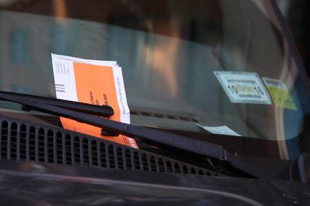 law breaker: NEW YORK - NOVEMBER 3, 2015: Illegal Parking Violation Citation On Car Windshield in New York Editorial