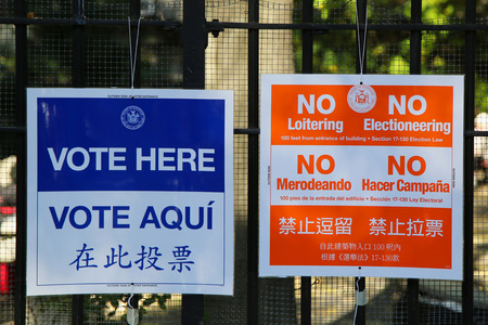 NEW YORK - NOVEMBER 3, 2015: Signs at the voting site in New York.The Voting Rights Act of 1965 is a national legislation in the United States that prohibits discrimination in voting
