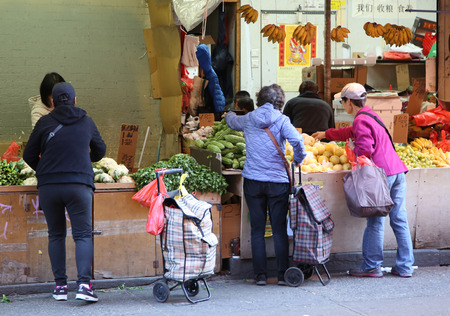 enclave: NEW YORK - NOVEMBER 5, 2015: Street scene in Chinatown in New York. Chinatown, Manhattan is a neighborhood in Manhattan that is home to the largest enclave of Chinese people in the Western Hemisphere Editorial