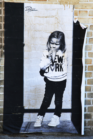 stencil art: NEW YORK - NOVEMBER 8, 2015: Stencil art at East Williamsburg in Brooklyn.Outdoor art gallery known as the Bushwick Collective has most diverse collection of street art in Brooklyn