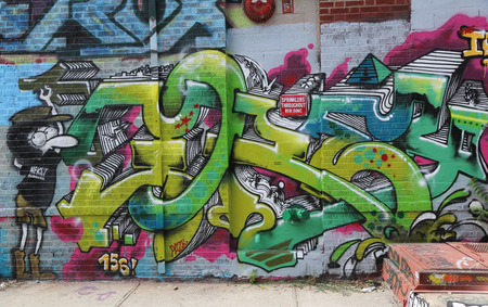 NEW YORK - JULY 24, 2014: Graffiti art at East Williamsburg in Brooklyn. Outdoor art gallery known as the Bushwick Collective has most diverse collection of street art in Brooklyn Redakční