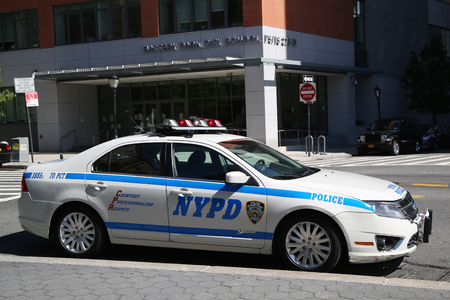 new world order: NEW YORK - SEPTEMBER 24, 2015: NYPD car provide security near Freedom Tower in Lower Manhattan
