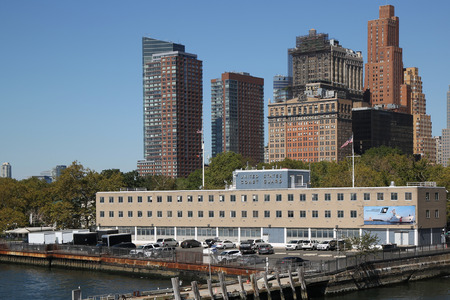 hudson river: NEW YORK - SEPTEMBER 24, 2015: A United States Coast Guard station on the southern end of Manhattan overlooks the Hudson River and New York City s Upper Bay.