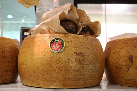 longaniza: NEW YORK -NOVEMBER 3, 2015: Cheeses in Italian store in New York. Little Italy is a neighborhood in lower Manhattan once known for its large population of Italians