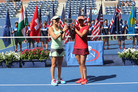 doubles: NEW YORK - SEPTEMBER 13, 2015: Five times Grand Slam champion Martina Hingis L and Sania Mirza R during women s doubles trophy presentation at US Open 2015