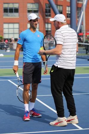 boris: NEW YORK - SEPTEMBER 3, 2015: Six times Grand Slam champion Boris Becker coaching Novak Djokovic for US Open 2015 at Billie Jean King National Tennis Center in New York Editorial