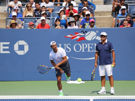nadal: NEW YORK - AUGUST 30, 2015: Fourteen times Grand Slam Champion Rafael Nadal of Spain with his coach Tony Nadal practices for US Open 2015 at Billie Jean King National Tennis Center in New York Editorial