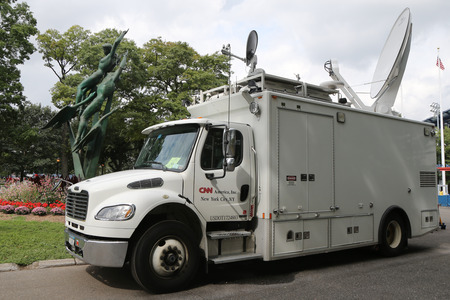 NEW YORK - SEPTEMBER 12, 2015: CNN truck in the front of National Tennis Center. CNN was the first channel to provide 24-hour television news coverage Reklamní fotografie - 48185130