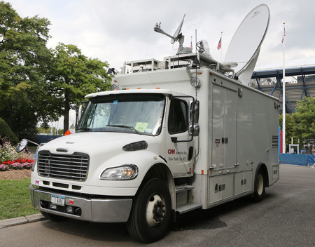eyewitness: NEW YORK - SEPTEMBER 12, 2015: CNN truck in the front of National Tennis Center. CNN was the first channel to provide 24-hour television news coverage