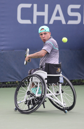 billie: NEW YORK - SEPTEMBER 12, 2015: Tennis player Andrew Lapthorne of Great Britain in action during Wheelchair Quad Singles semifinal match at US OPEN 2015 at Billie Jean King National Tennis Center in NY