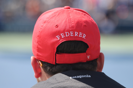billie: NEW YORK - SEPTEMBER 13, 2015: Tennis fan wears Roger Federer s hat during US Open 2015 match at Billie Jean King National Tennis Center in New York