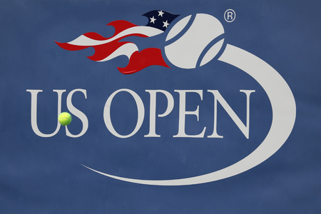 comprising: NEW YORK  - AUGUST 30, 2015:  US Open sign at Billie Jean King National Tennis Center in Flushing, NY. US Open is a final tennis major comprising the Grand Slam each year
