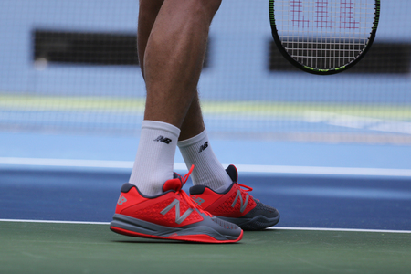 professional practice: NEW YORK - AUGUST 25, 2015: Professional tennis player Milos Raonic of Canada wears custom New Balance tennis shoes during practice  at US Open 2015 at Billie Jean King National Tennis Center