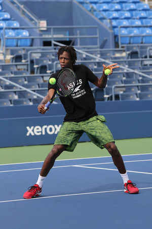 us open: NEW YORK - AUGUST 24, 2015: Professional tennis player Gael Monfis of France practices for US Open 2015 at Billie Jean King National Tennis Center in New York Editorial
