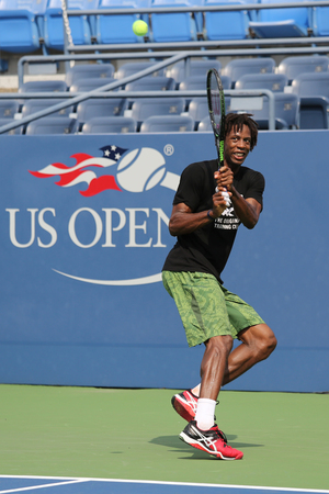 billie: NEW YORK - AUGUST 24, 2015: Professional tennis player Gael Monfis of France practices for US Open 2015 at Billie Jean King National Tennis Center in New York Editorial