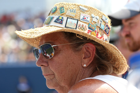 billie: NEW YORK - SEPTEMBER 1, 2015: Tennis fan wears hat with sport collector pins during US Open 2015 at Billie Jean King National Tennis Center in New York