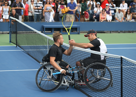 NEW YORK - SEPTEMBER 13, 2015: US Open 2015 champion Dylan Alcott of Australia L with David Wagner R after Wheelchair Quad Singles final match at Billie Jean King National Tennis Center in NY