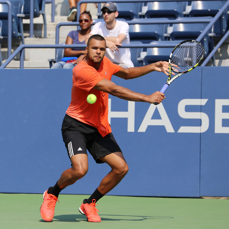 professional practice: NEW YORK - AUGUST 30, 2015: Professional tennis player Jo-Wilfried Tsonga of France in practice for US Open 2015 at National Tennis Center in New York Editorial