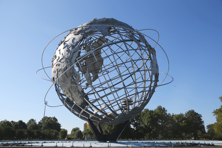flushing: NEW YORK - SEPTEMBER 7, 2015: 1964 New York World s Fair Unisphere in Flushing Meadows Park. It is the worlds largest global structure, rising 140 feet and weighing 700 000 pounds Editorial