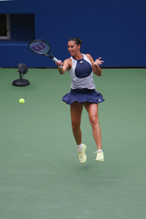 racket stadium: NEW YORK - SEPTEMBER 12, 2015: US Open 2015 champion Flavia Pennetta of Italy in action during her final match at US Open 2015 at National Tennis Center in New York Editorial