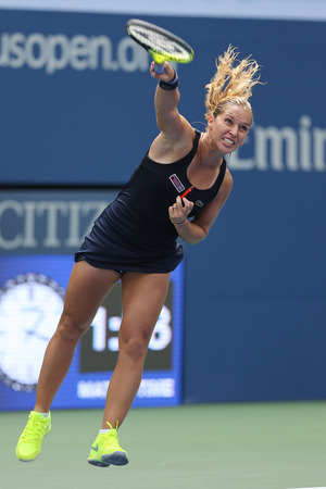 us open: NEW YORK - AUGUST 31, 2015: Professional tennis player Dominika Cibulkova of Slovakia in action during first round match at US Open 2015 at Billie Jean King National Tennis Center in New York