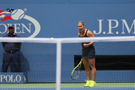 grand hard: NEW YORK - AUGUST 31, 2015: Professional tennis player Dominika Cibulkova of Slovakia in action during first round match at US Open 2015 at Billie Jean King National Tennis Center in New York