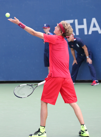 us open: NEW YORK - SEPTEMBER 1, 2015:Professional tennis player Alexander Zverev of Germany in action during his first round match at US Open 2015 at Billie Jean King National Tennis Center in New York Editorial