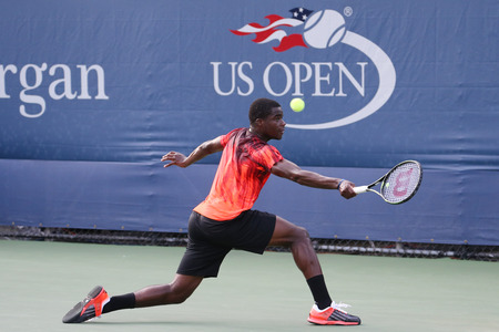 billie: NEW YORK - SEPTEMBER 1, 2015:Professional tennis player Frances Tiafoe of United States in action during his first round match at US Open 2015 at Billie Jean King National Tennis Center in New York