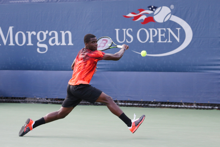 grand hard: NEW YORK - SEPTEMBER 1, 2015:Professional tennis player Frances Tiafoe of United States in action during his first round match at US Open 2015 at Billie Jean King National Tennis Center in New York